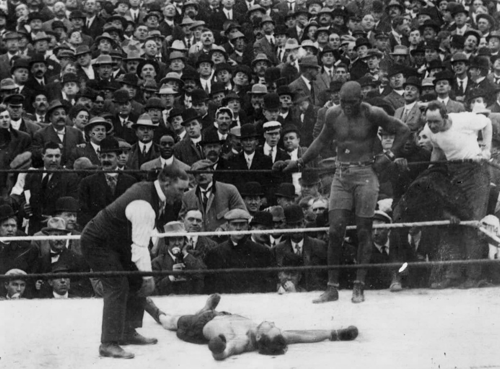 Jack Johnson knocks out Stanley Ketchel in the 12th round after being knocked down by Kerchel earlier in the round.