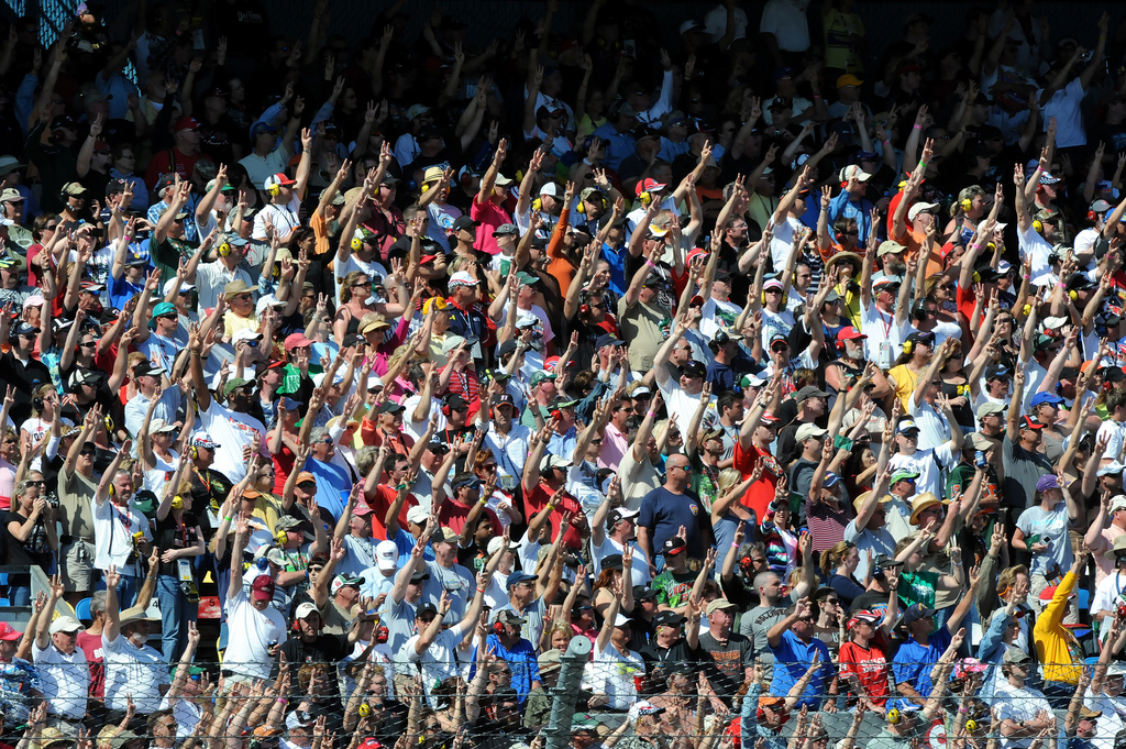 NASCAR fans hoist three fingers into the air during the third lap of the 53rd running of the Daytona 500 on Sunday to honor the late Dale Earnhardt, who was killed in a crash here 10 years ago while driving the No. 3 Goodwrench Chevrolet. U.S. Army photo by Tim Hipps, FMWRC Public Affairs