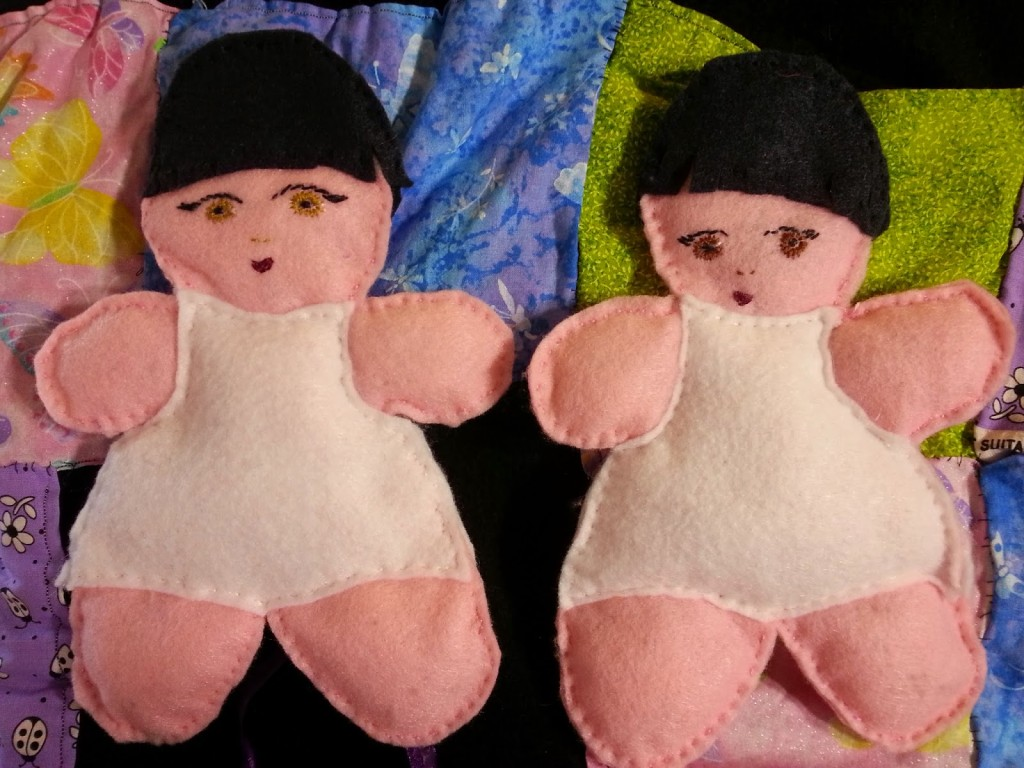 The two girl dolls with their sewn on undies