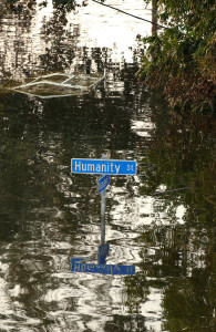 Flooded residential street with sign marking intersection of Humanity and Mandeville Streets. Jocelyn Augustino / FEMA