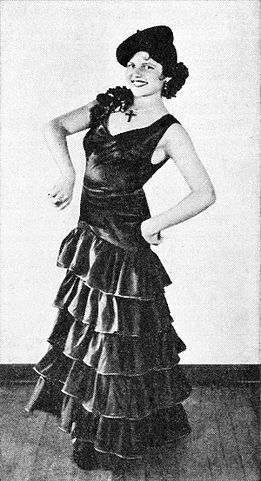 Rita, as her father's professional dancing partner in 1931
