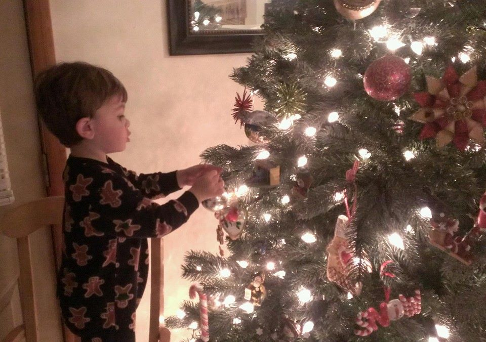 Tyler decorating the tree