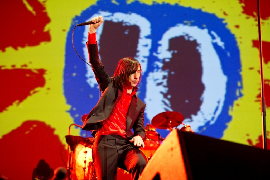 Bobby Gillespie of Primal Scream in front of a Paul Cannell backdrop.