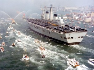 HMS Invincible returns to massive celebrations following the Falklands Conflict in 1982.