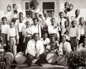 "Dillard High School has been recognized for its premier music and dance programs. Here, band director George A. Dean poses with the first band in the school's history (1946). Two years later, Dean was succeeded by legendary saxophonist Julian Edwin ""Cannonball"" Adderley."